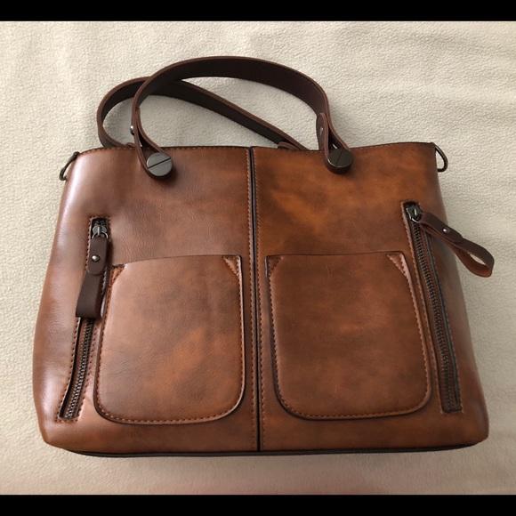 Brown Handbag. M 5b267dbdbb76156caec714fd 2bee93311e65b